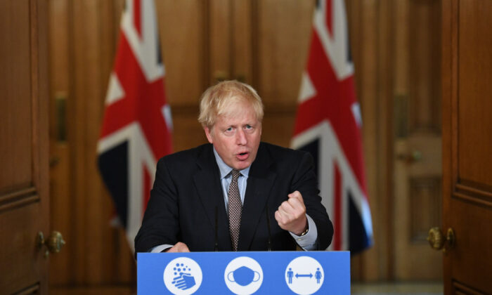 To announce that from Sept. 14, people in England will only be allowed to socialize in groups of six or less, Prime Minister Boris Johnson attends a virtual press conference at Downing Street in London on Sept. 9, 2020. (Stefan Rousseau-WPA Pool/Getty Images)
