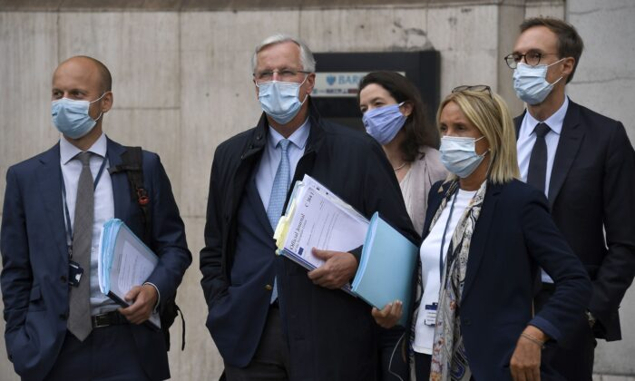 EU Chief negotiator Michel Barnier (Second L) arrives with his team at the Westminster Conference Centre in London on Sept. 9, 2020, where U.K. and EU officials began the eighth round of Brexit negotiations. (AP Photo/Alberto Pezzali)