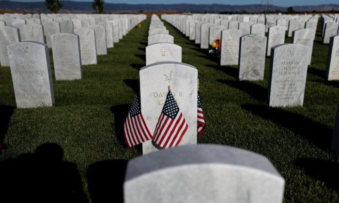 Flags are displayed next to headstones in Dixon, Calif., on May 24, 2020. (Justin Sullivan/Getty Images)