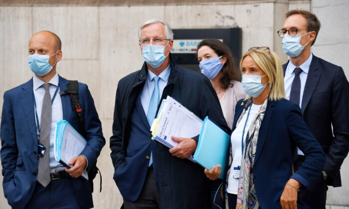 EU Chief negotiator Michel Barnier , second from left, arrives with his team at the Westminster Conference Center in London, on Sept. 9, 2020. (Alberto Pezzali/ AP Photo)