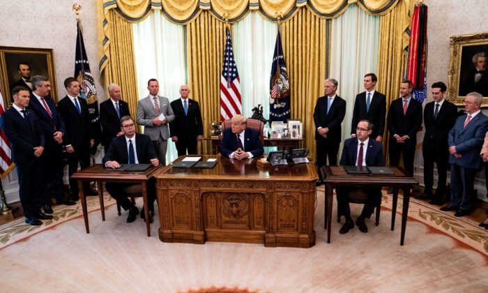 President Donald Trump (C) participates in a signing ceremony and meeting with the Serbian President Aleksandar Vucic (L) and the Kosovo Prime Minister Avdullah Hoti (R) in the Oval Office of the White House in Washington on Sept. 4, 2020. (Anna Moneymaker/Pool/Getty Images)