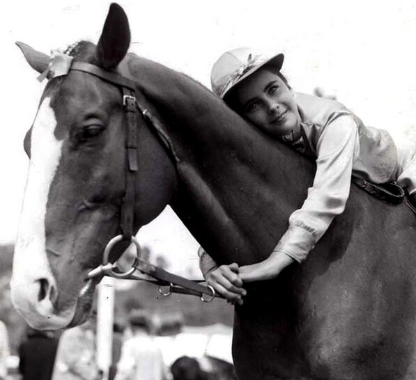 """girl with arms around horse's neck in """"National Velvet"""""""