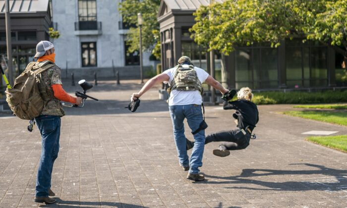 A man attacks a counter-protester during pro-President Donald Trump rally in Salem, Ore., on Sept. 7, 2020. (Nathan Howard/Getty Images)