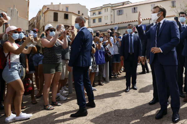 Emmanuel Macron meets with residents