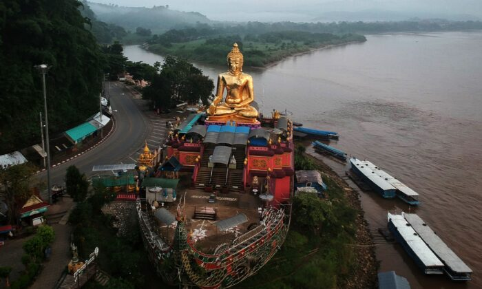 This aerial photo taken on Sept. 20, 2019 shows a giant Buddha on the Thai side of the Golden Triangle in Chiang Rai province. China wants to cut a canal through southern Thailand to build a bypass to the Strait of Malacca. (LILLIAN SUWANRUMPHA/AFP via Getty Images)