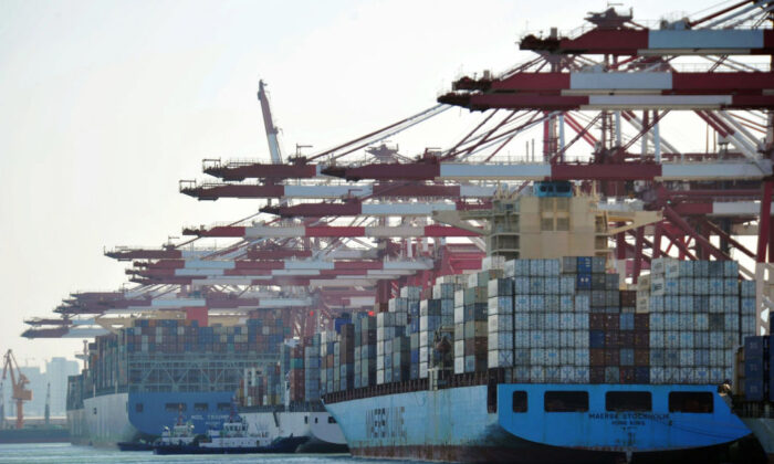 Cargo containers are loaded on container ships at a port in Qingdao, a city in eastern China's Shandong Province, on April 8, 2018. (AFP via Getty Images)