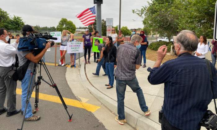 Parents and educators gather to call for the immediate reopening of in-person learning in Orange County schools in Irvine, Calif., on Sept. 8, 2020. (Jack Bradley/The Epoch Times)