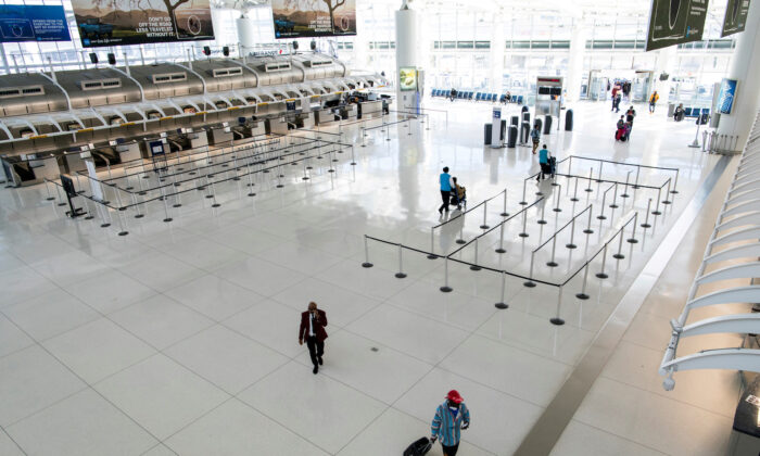 People walk around the terminal at the John F. Kennedy International Airport in New York on March 9, 2020. (Eduardo Munoz/File Photo via Reuters)