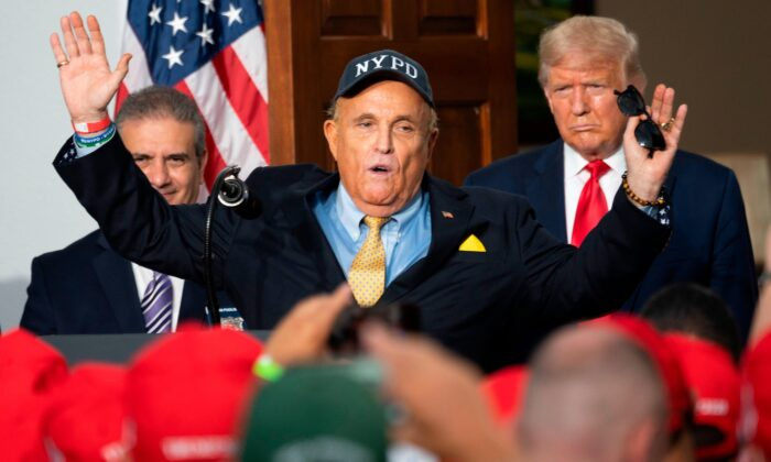 US President Donald Trump (R) listens as his personal lawyer Rudy Giuliani speaks to the City of New York Police Benevolent Association at the Trump National Golf Club in Bedminster, NJ, on Aug. 14, 2020. (Jim Watson/AFP via Getty Images)
