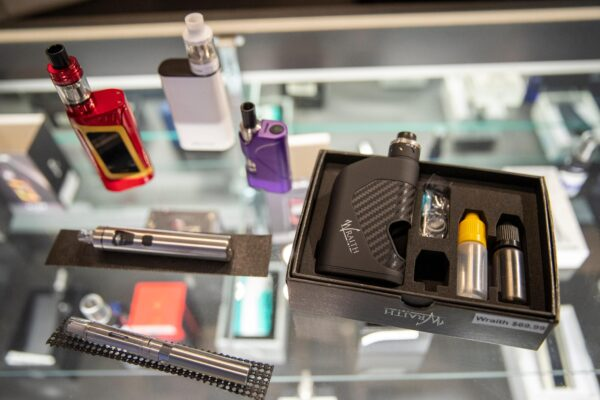 Vaping devices are displayed at a store