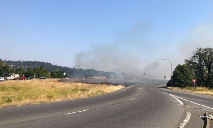 A brush fire is seen in the median of a state highway in Puyallup, Wash., on Sept. 9, 2020. (Washington State Patrol Trooper Ryan Burke)