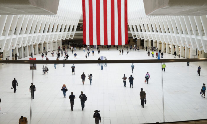 People walk through the Oculus transportation hub and mall on the first day of the reopening of malls to the public for shopping since the outbreak of COVID-19, in New York City, on Sept. 09, 2020. (Spencer Platt/Getty Images)