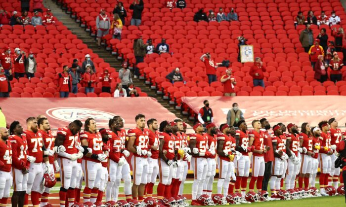 Members of the Kansas City Chiefs stand united with locked arms before the start of a game against the Houston Texans at Arrowhead Stadium in Kansas City, Mo., on Sept. 10, 2020. (Jamie Squire/Getty Images)