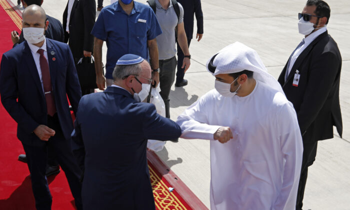 Israeli National Security Adviser Meir Ben-Shabbat, center left, bumps elbows with an Emirati official as he leaves Abu Dhabi, Arab Emirates, on Sept. 1, 2020. (Nir Elias/Pool via AP)