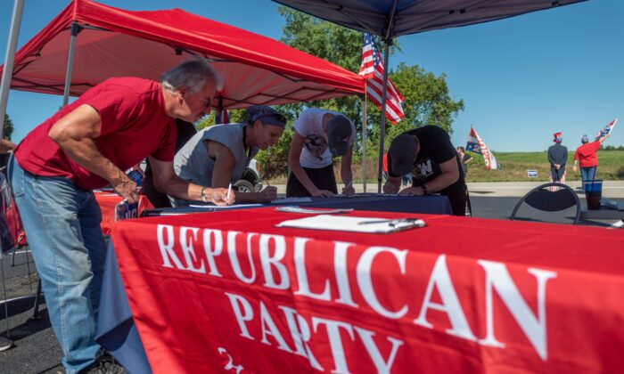 People register to vote during a Republican voter registration in Brownsville, Pennsylvania, on Sept. 5, 2020. (Andrew Caballero-Reynolds/AFP via Getty Images)