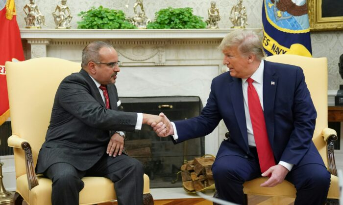 President Donald Trump (R) shakes hands with Bahrain's Crown Prince Salman bin Hamad bin Isa al-Khalifa during a meeting in the Oval Office of the White House in Washington on Sept. 16, 2019. (Mandel Ngan/AFP via Getty Images)