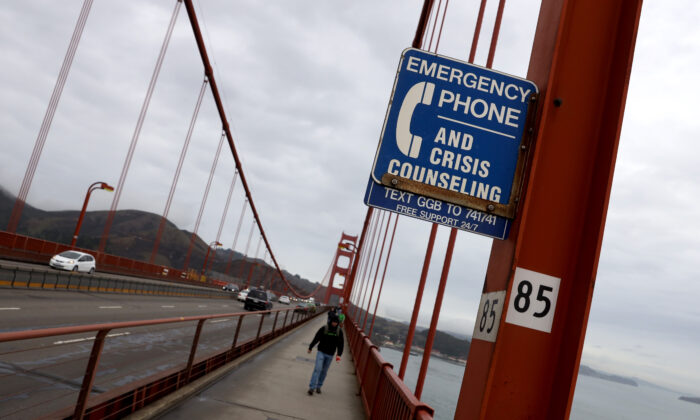 A sign is posted alerting people to use an emergency crisis counseling phone if in distress on the Golden Gate Bridge in San Francisco on Dec. 13, 2019. (Justin Sullivan/Getty Images)