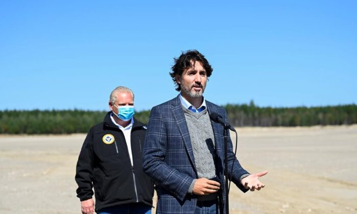 Canadian Prime Minister Justin Trudeau, front, speaks as Ontario Premier Doug Ford listens after taking part in a ground breaking event at the Iamgold Cote Gold mining site in Gogama, Ont., on September 11, 2020. (The Canadian Press/Nathan Denette)