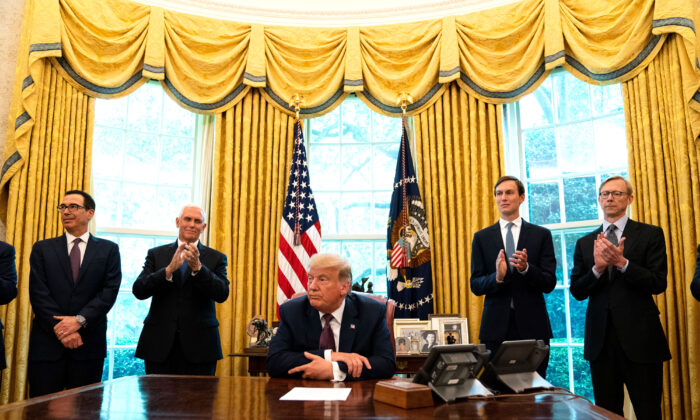 (L-R): Treasure Secretary Steven Mnuchin, Vice President Mike Pence, President Donald Trump, and Advisor Jared Kushner, speak in the Oval Office to announce that Bahrain will establish diplomatic relations with Israel, at the White House in Washington, on Sept. 11, 2020. (Anna Moneymaker-Pool/Getty Images)
