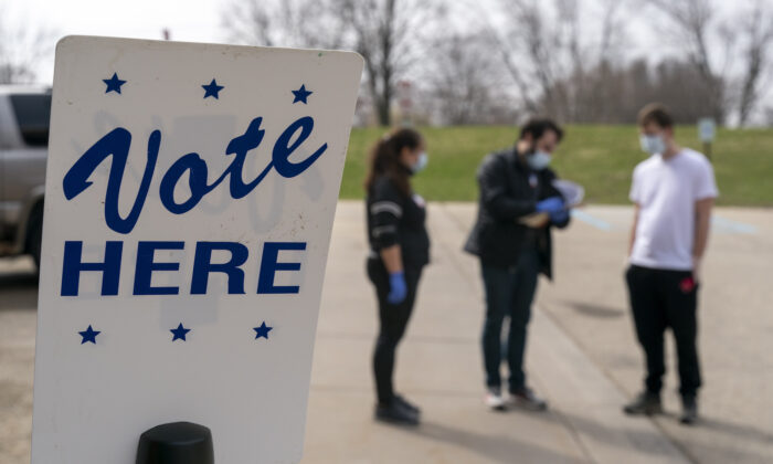 Poll workers are seen during curbside voting in Madison, Wis., on April 7, 2020. (Andy Manis/Getty Images)