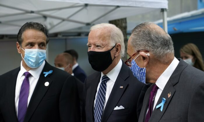 Democratic presidential candidate and former Vice President Joe Biden walks between Sen. Chuck Schumer (D-N.Y.), right, and New York Gov. Andrew Cuomo, at the National September 11 Memorial in New York, Sept. 11, 2020. (Patrick Semansky/AP Photo)