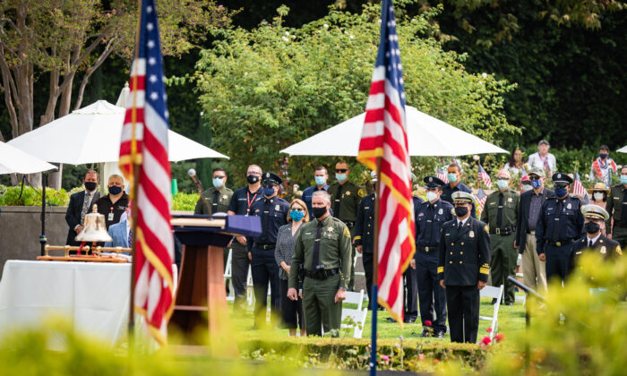 Orange County Sheriff Don Barnes, center, stands in front of uniformed first responders at the opening of the annual 9/11 memorial ceremony at the Richard Nixon Library and Museum in Yorba Linda, Calif., on Sept. 11, 2020. (John Fredricks/The Epoch Times)