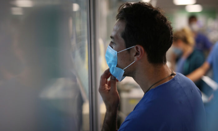 A medical worker watches COVID-19 patients in a Marseille hospital in France, on Sept.10, 2020. (Daniel Cole/AP Photo)