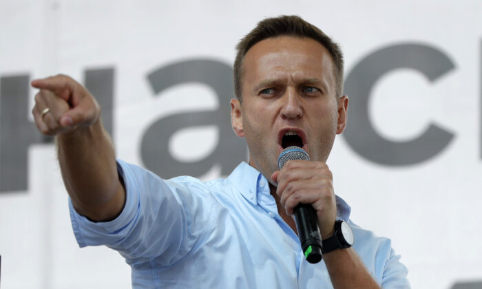 In this file photo, Russian opposition activist Alexei Navalny gestures while speaking to a crowd during a political protest on in Moscow, Russia, on  July 20, 2019,. (Pavel Golovkin/AP)