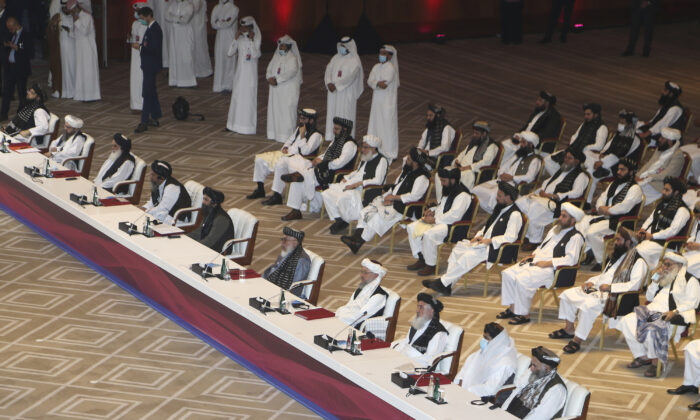 Taliban negotiator Abbas Stanikzai, fifth right, with his delegation attend the opening session of the peace talks between the Afghan government and the Taliban in Doha, Qatar, Sat., Sept. 12, 2020. (Hussein Sayed/AP Photo)