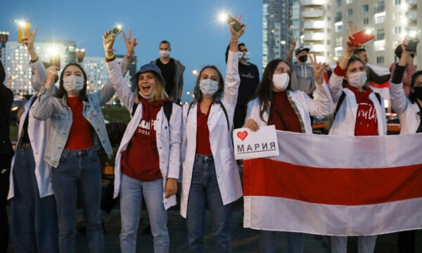 Belarusian medical workers gesture during a rally