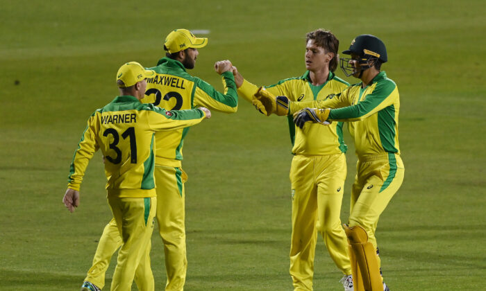 Adam Zampa of Australia celebrates with  Glenn Maxwell, Alex Carey and David Warner of Australia  during the 1st Royal London One Day International Series match between England and Australia at Emirates Old Trafford in Manchester, England on Sept. 11, 2020. (Shaun Botterill/Getty Images)