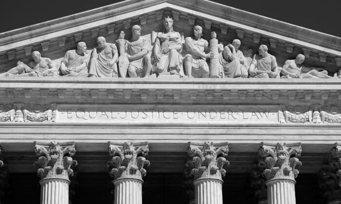 "A pediment on the U.S. Supreme Court building with sculptural reliefs pertaining to law and order. Below the reliefs is the inscription ""Equal justice under law."" (The History Press)"