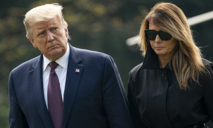 President Donald Trump and first lady Melania Trump return to the White House in Washington on Sept. 11, 2020. (Drew Angerer/Getty Images)