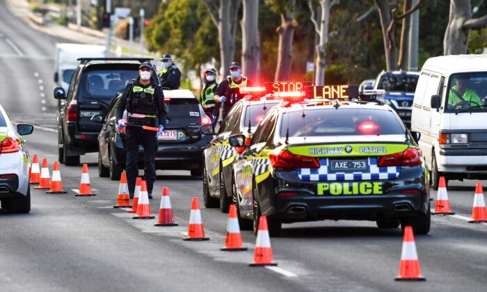 Police pull vehicles aside at a checkpoint in the locked-down suburb of Broadmeadows in Melbourne on July 2, 2020. (William West/AFP via Getty Images)