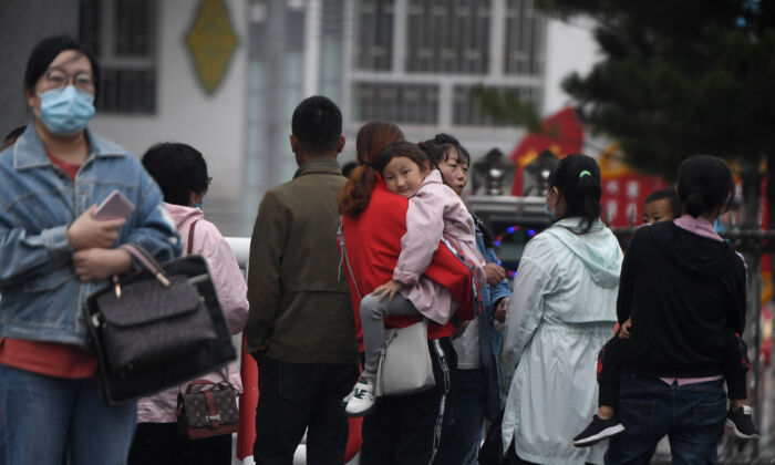 Parents wait outside a school in Tongliao, in northern China's Inner Mongolia on September 10, 2020. (NOEL CELIS/AFP via Getty Images)