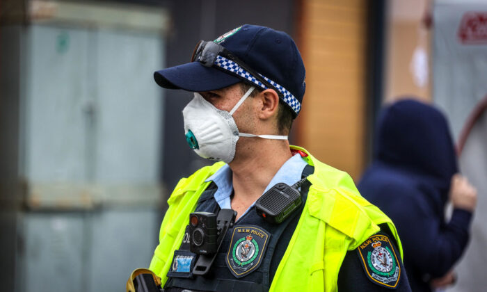 A NSW policeman wearing a face mask at a 'pop-up' clinic in Albury, Australia on July 7, 2020. (David Gray/Getty Images)