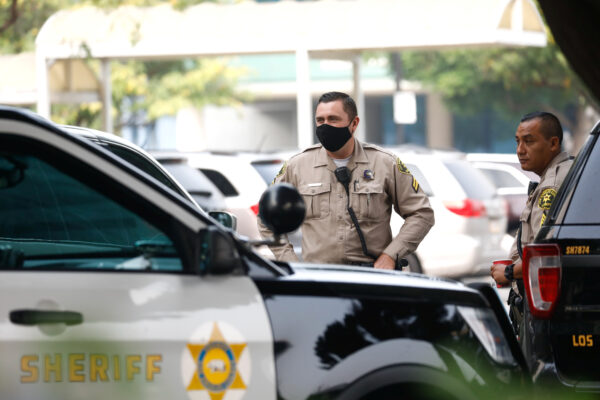 deputies stand outside St. Francis Medical Center hospital