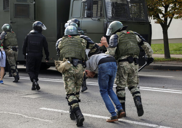 Law enforcement officers detain a protester Minsk