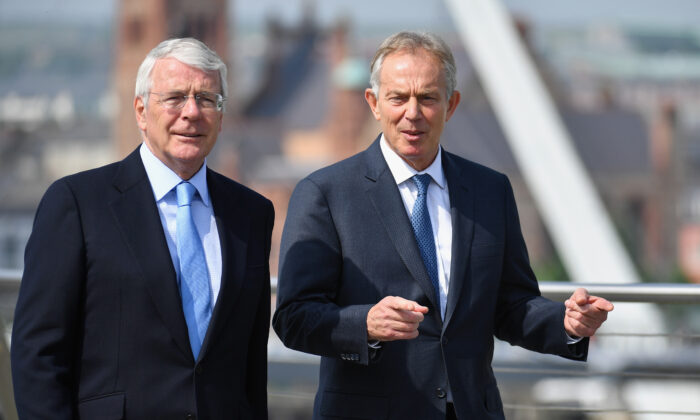 Sir John Major and Tony Blair speak as they walk across the Peace Bridge in Derry, Northern Ireland, on June 9, 2016. (Jeff J Mitchell-WPA Pool/Getty Images)