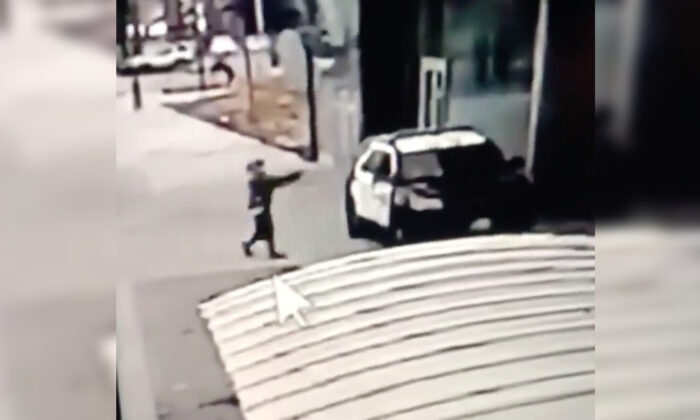 In this still image from video, a man walks up to sheriff's deputies and opens fire without warning or provocation in Compton, Calif., on Sept. 12, 2020. (Los Angeles County Sheriff's Department via AP)