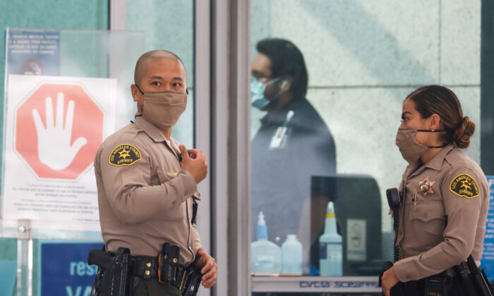 Los Angeles County Sheriffs Department (LASD) deputies stand outside St. Francis Medical Center hospital following the ambush shooting of two deputies in Compton, in Lynwood, Calif., on Sept. 13, 2020. (Patrick T. Fallon/Reuters)