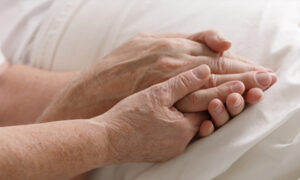 Elderly Couple Dies From COVID-19 Holding Hands, Son Pleads 'Virus Isn't a Hoax'