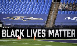 Ravens Stand for 'Black National Anthem,' but Most Sit or Kneel During National Anthem