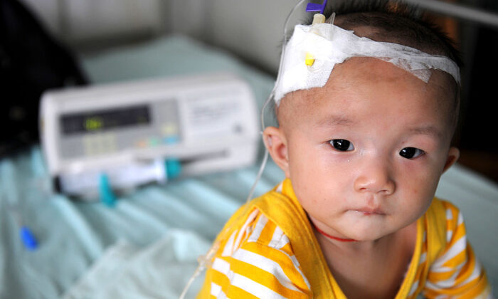 A baby who suffers from kidney stones after drinking tainted milk powder, gets IV treatment at the Chengdu Children's Hospital in China's Sichuan Province, on Sept. 22, 2008. (China Photos/Getty Images)