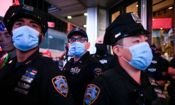 NYPD officers stand guard during a protest in New York City, on Sept. 3, 2020. (Kena Betancur/AFP via Getty Images)