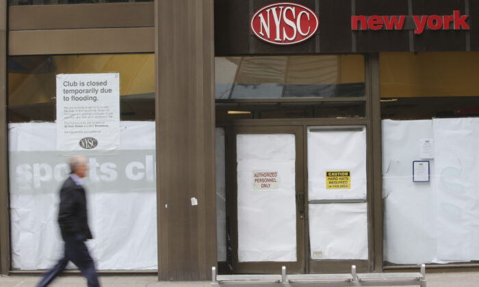 A man walks past a shuttered New York Sports Club on Water St. in New York City, N.Y., on Feb. 7, 2013. (Mary Altaffer/AP Photo)
