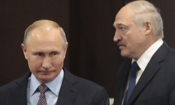 Russian President Vladimir Putin, left, and Belarusian President Alexander Lukashenko meet in the Black Sea resort of Sochi, Russia, on Feb. 15, 2019. (Sergei Chirikov/AP Photo)