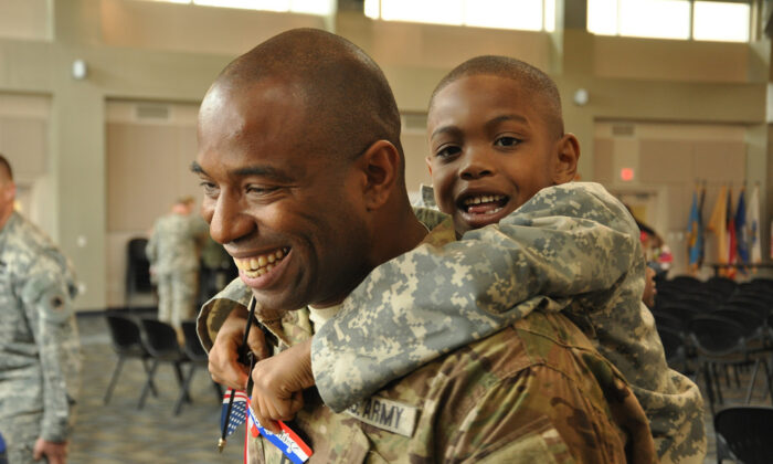 Georgia Army National Guard Capt. Chad Tyson receives a hug from son Chase during a welcome home ceremony in Marietta, Ga., after a 10-month deployment to Afghanistan, on Nov. 22, 2013. (Courtesy of the National Guard Flickr page)