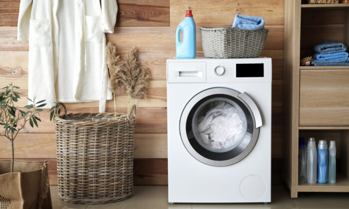 You can add baking soda to the wash cycle to boost liquid detergent. (Pixel-Shot/Shutterstock)