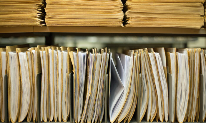 Have a designated place for paperwork, so it doesn't end up all over your home. (Harry Huber/Shutterstock)